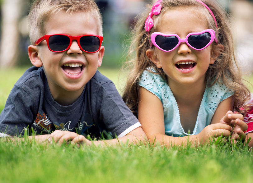 Cute small kids with fancy sunglasses