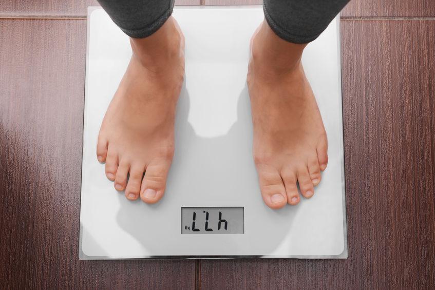 Persona che pesa 47,7 kg
